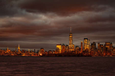 Moody night view of New York Manhattan downtown over Hudson river