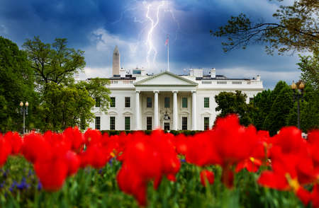 Storm moody sky over White House, residence and workplace of the president of the United States view with red tulips, concept idea Reklamní fotografie