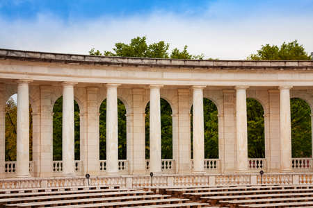 Column, benches and scene The Arlington Memorial Amphitheater at National Cemetery, Virginia with dark gloomy sky