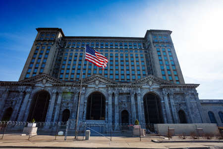 Abandoned Michigan Central Train Depot main entrance view with USA flag in front of it