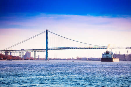 Ambassador Bridge view from Detroit, MI USA to Windsor Ontario Canada and freight boat