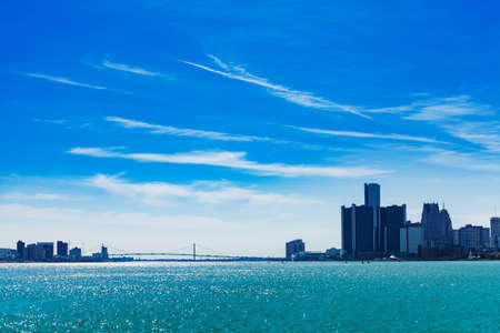 Ambassador Bridge panorama over Detroit river and city on sunny day from sunset point of Belle Isle