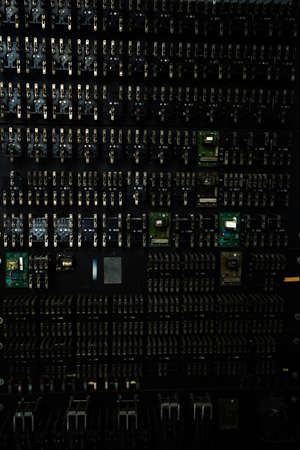 Close-up of an old telephone control panel with tumblers and switches over black back Standard-Bild