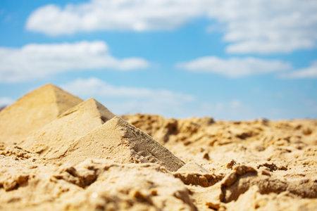 Miniature pyramids in desert made of sand on beach