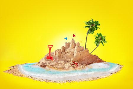 Summer concept sand island and sandcastle on beach