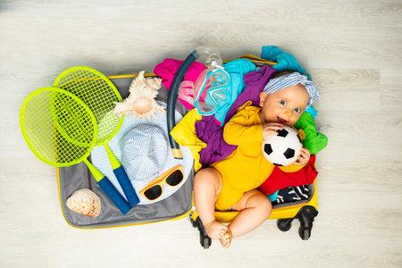 Baby girl lay in the travel suite full of things Zdjęcie Seryjne
