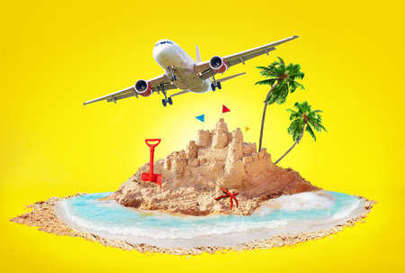 Summer vacation concept plane sandcastle and beach