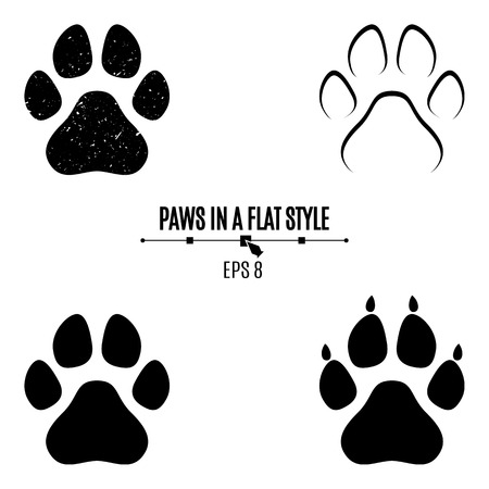 A set of dogs paws. Black traces in different styles. Isolated on white background. Silhouettes of paws. Vector illustration