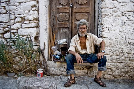 dirty old man: The portrait of famous drunk living in castle street of Marmaris-Turkey