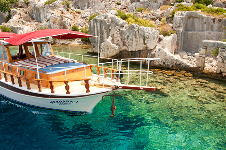 sunken boat: Picture of a tour boat touring in the sunken lycian town ruins in Kas-Antalya-Turkey