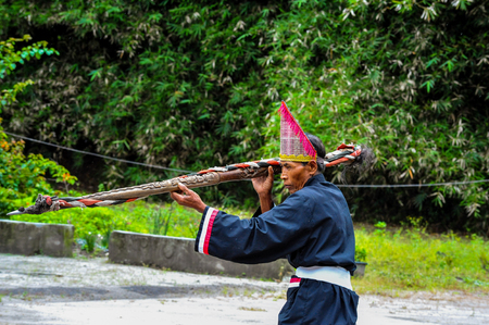A Traditional Batak Wizard performing in a ceremonial dance in Bolon Simanindo Batak Museum Village. Batak stands for the ethnic people living in the northern part of Sumatra Island of Indonesia.