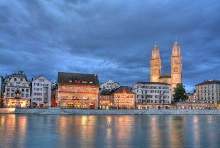 grossmunster cathedral: Zurich Grossmunster cathedral with river Limmat at night.