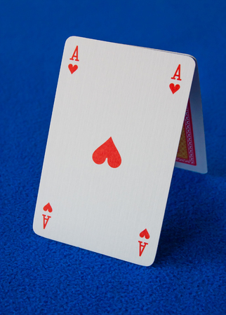 Poker playing cards isolated on a blue background. Фото со стока