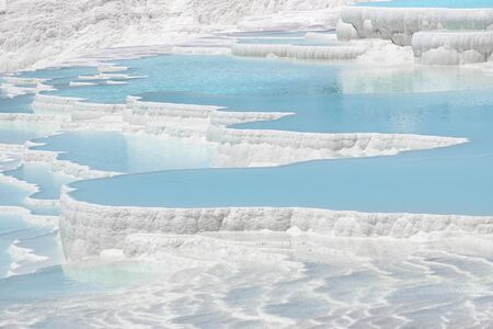 Pamukkale travertines pools and terraces. Denizli, Turkey. Natural site of hot springs and travertines, terraces of carbonate minerals.
