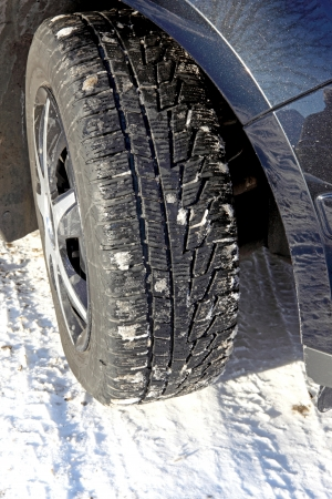 Car tire in the winter way photo