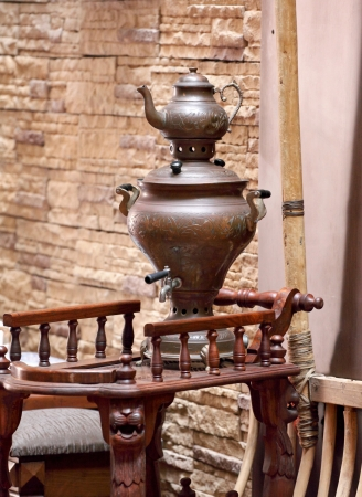 A very old samovar on the table photo