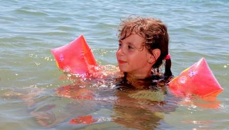 enjoymant: A small girl on the sea