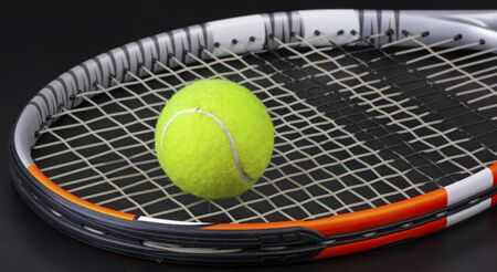 tennis racket and ball on black background Stock fotó - 137921945