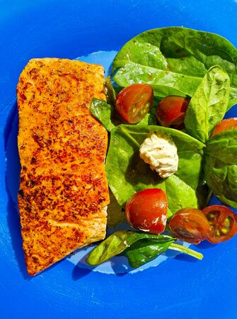 a very tasty fish on the blue plate