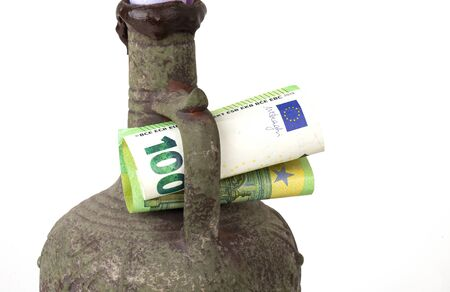 euro banknotes in a jugful on the white