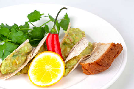 mexican tacos with avocado on the table