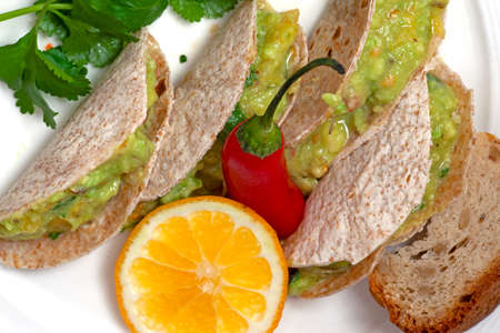 a mexican tacos with avocado on the table Stock Photo
