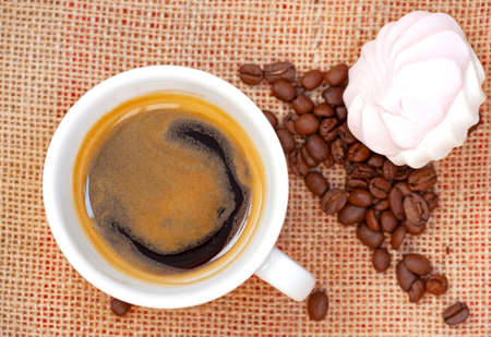 cup of coffee with marshmallow on table Stock Photo