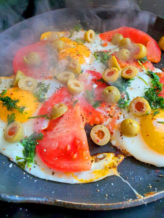 a fried eggs in a pan