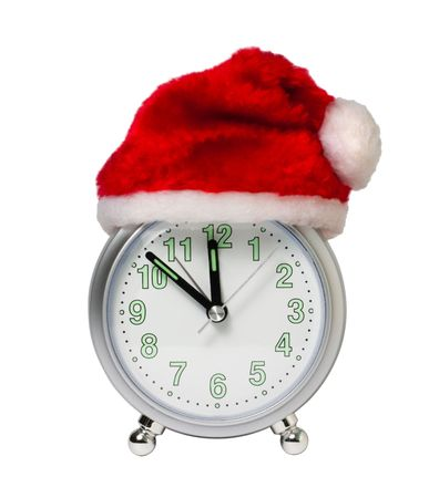 clock in the hat of Santa  isolated on white  background photo