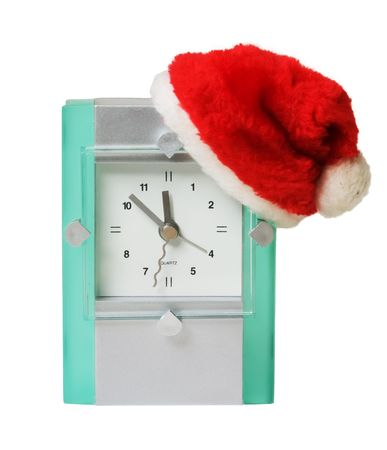 clock in the hat of Santa Claus isolated on white photo