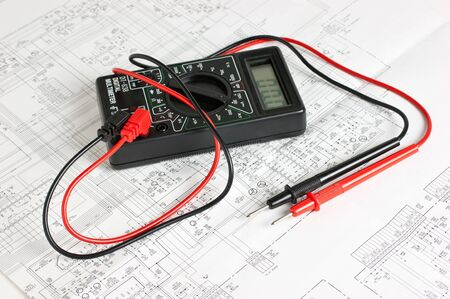 multimeter: multimeter on the background of electronic circuits