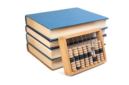 Wooden abacus on a pile of books isolated on white Stock Photo - 6995692