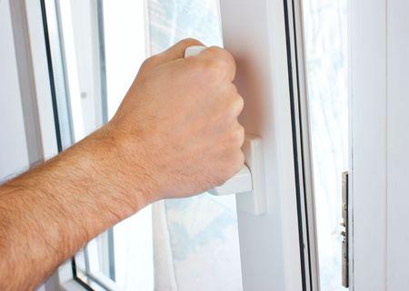 windows and doors: hand opens a window