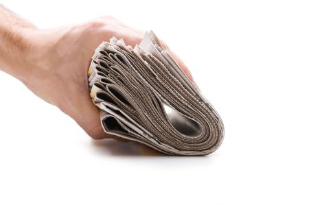 hand holds a bundle of newspapers isolated on a white background Stock Photo - 7176970