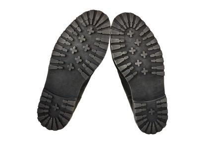 pieds sales: seul militaires bottes isol�e sur fond blanc