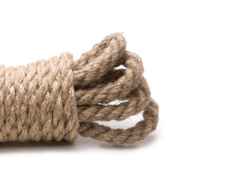 braided flexible: coil of hemp rope isolated on a white background Stock Photo