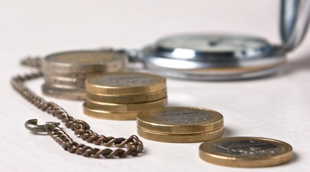 old pocket watches and coins Stock Photo - 7342810