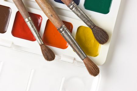 watercolor paints and art brushes