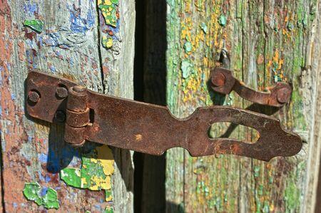rusty:  old rusty lock on the wooden door