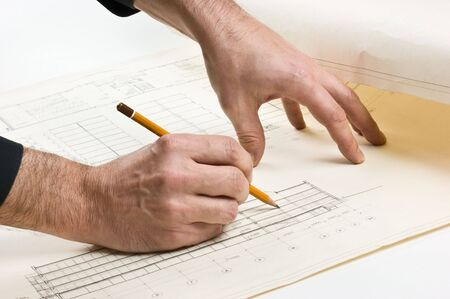hand draws a pencil on the drawing photo