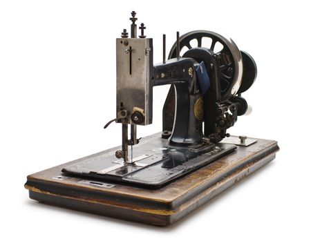 Old sewing machine  isolated on a white background Stock Photo - 7541941