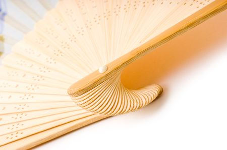 Folding fan isolated on a white background. photo