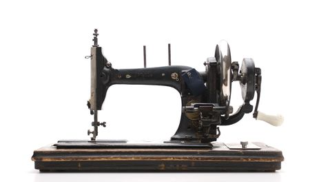 Old sewing machine  isolated on a white background Stock Photo - 7749581