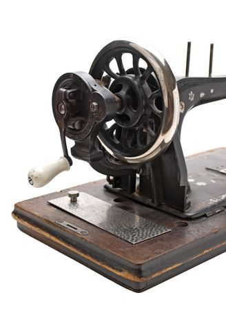 Old sewing machine  isolated on a white background photo
