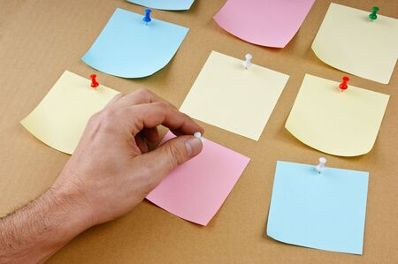 pasteboard: reminder notes on the pasteboard Stock Photo