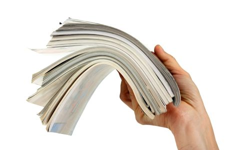 medium body: magazine in hand isolated on a white background