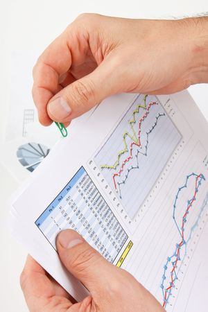 working paper with a diagram  in hand photo