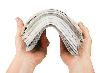 magazine in hand isolated on a white background Stock Photo - 7937860