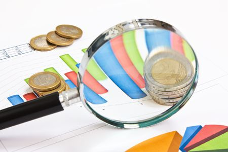 magnifying glass and the working paper with coinss photo