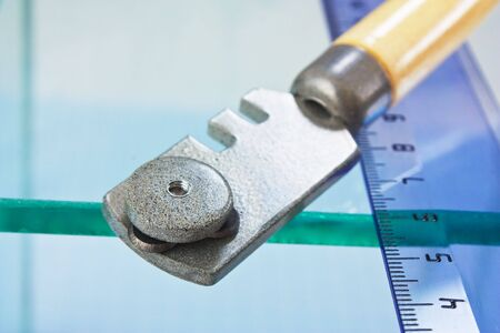 glass cutter and  ruler on the glass Stock Photo - 8048799